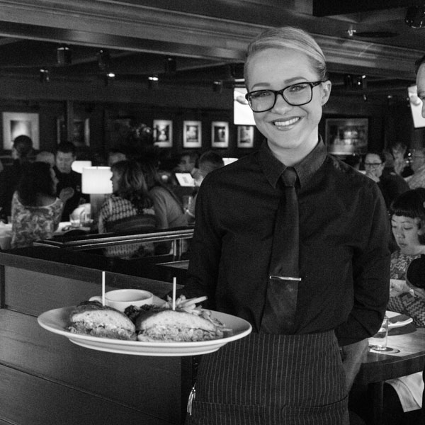 smiling server with french dip
